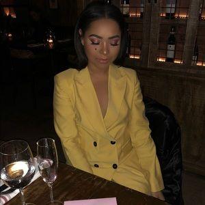 Loose fitting yellow blazer